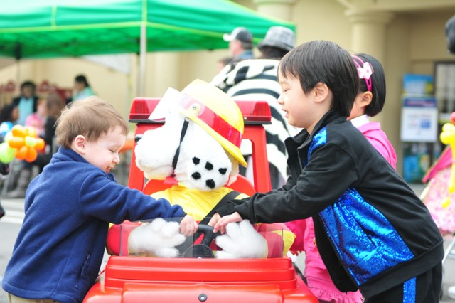 Children play with a display at the Spring Festival April 2, held at the Camp Red Cloud Community Activity Center.