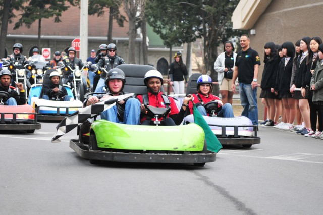 Go-karts from the Casey 500 Go-Kart Track join the Community Spring Festival parade and activities at Camp Red Cloud April 2.