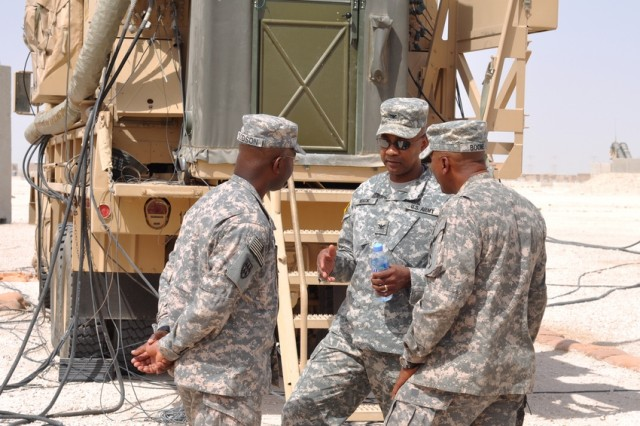Col. Lorenzo Mack, deputy chief of staff G-3, U.S. Army Space and Missile Defense Command/Army Forces Strategic Defend, discusses the Patriot unit's site set up with Command Sgt. Maj. Finis Dodson of 69th Air Defense Artillery Brigade and Sgt. Maj. Greg Boone, 32nd Army Air Missile Defense Command, April 8 at Al Udeid Air Base in Qatar.