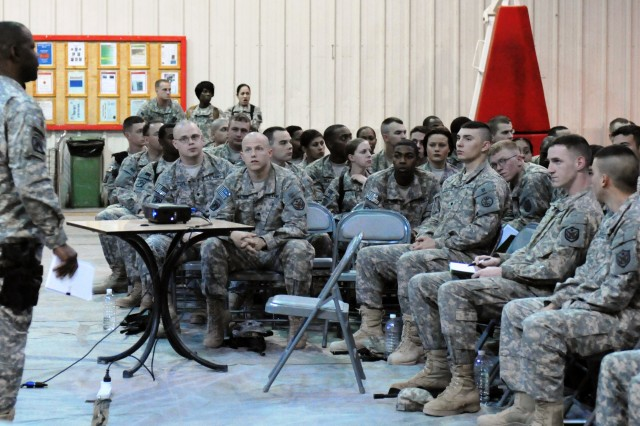 Command Sgt. Maj. Joseph R. Allen speaks with junior enlisted service members during a conference on Camp Liberty, March 29. Allen hosted this conference to provide updates on the mission, address concerns and to interact with service members at the junior enlisted level.