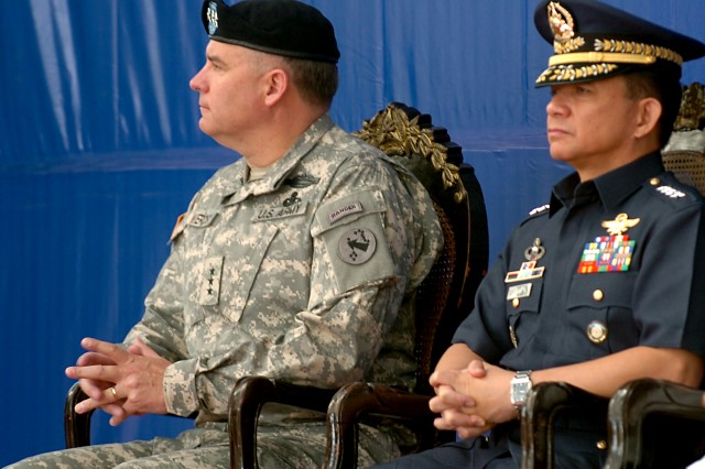 "Lt. Gen. Francis Wiercinski (left), U.S. Army Pacific commander, and Armed Forces of the Philippines Army Gen. Eduardo Oban, look on during closing ceremonies for the bilateral training event Balikatan 2011 April 15 at Camp Aguinaldo, Philippines. Balikatan, which means ""shoulder-to-shoulder"" in Tagalog, the official language of the Philippines, is an annual joint exercise military exercise between the armed forces of the U.S. and Republic of the Philippines."
