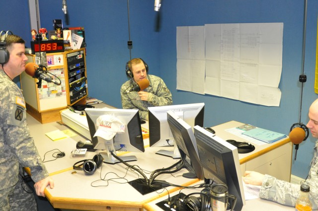 "AFN-Wiesbaden station manager Sgt. 1st Class Daniel Carr (from left) joins Air Force Staff Sgts. Tony Plyler and Tyler Alexander in ""The Shack"" for some spirited debate during weekday morning show."