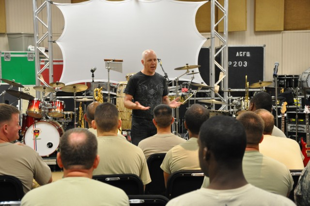 Lang Bliss, Tom Jackson Productions's live music producer, provides Soldiers with feedback on their performances.  He also explains to The Army Ground Forces Band's Brass Brigade and Loose Cannons what his expectations are from the two groups in the upcoming days of training.
