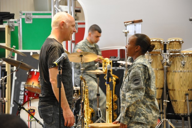 Lang Bliss, Tom Jackson Productions's live music producer, and The Army Ground Forces Band's vocalist Sgt. Shirley Dirden take time during a break to discuss some of the changes that were made to her performance.