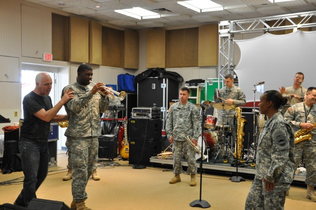 Lang Bliss, Tom Jackson Productions's live music producer, shows The Army Ground Forces Band's Brass Brigade's trumpeter, Sgt. Joshua Price, the correct stage positioning for his solo.