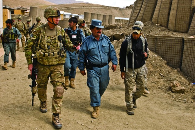 Lt. Col. Thomas S. Rickart shows Afghan National Police Chief Abdul Ghafoor Aziz around Combat Outpost Tangi April 8. Aziz, the chief of police for Sayed Abad District will take command of COP Tangi after TF Warrior has successfully transitioned the COP to Afghan National Security Forces.