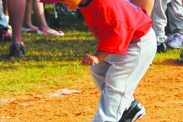 Ki Ventura, 3, son of Luis and Kaylee Ventura, gets ready for the start of Fort Polk's Wee Ball season.