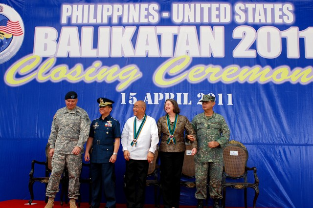 "From left to right, Lt. Gen. Francis Wiercinski, U.S. Army Pacific commander; Armed of the Forces Philippines Army Gen. Eduardo Oban, AFP chief of staff; Under Secretary of Defense Affairs Honorio Azcueta; Honorable Leslie Bassett, deputy chief of mission, U.S. Embassy to the Philippines; and Rear Admiral Victor Emmanuel, Philippine exercise director, stand together after the conclusion of closing ceremonies April 15 for Balikatan 2011 at Camp Aguinaldo, Philippines.  Balikatan, which means ""shoulder-to-shoulder"" in Tagalog, the official language of the Philippines, is an annual joint military exercise between the armed forces of the U.S. and Republic of the Philippines."