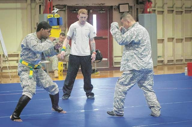 Adrian Smith (left) won first place in the cruiserweight category during the Fort Belvoir combatives tournament April 8 at Wells Field House. Smith also earned an award for Most Outstanding Competitor, based on his technical skills, stamina and overall abilities in each match.