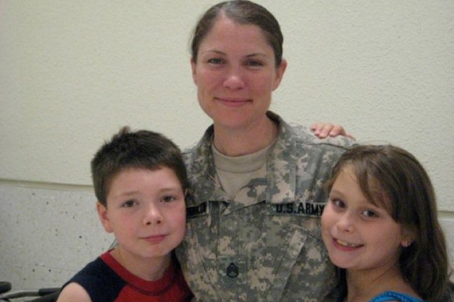 Amy McLaughlin poses with her children, Devin (left) and Hana (right) after arriving on R&R leave from Iraq July 2010.