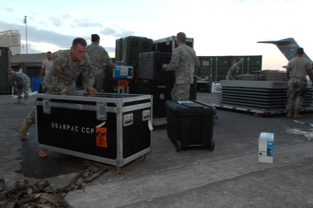 Soldiers from the U.S. Army pacific Contingency Command Post unload pallets of equipment shortly after arriving at Clark Air Base, Philippines, March 30, 2011. The CCP was at Clark taking part in a certification exercise. The CCP is a deployable command post that focuses on small scale contingencies such as disaster relief, humanitarian assistance and peace operations throughout the Pacific.