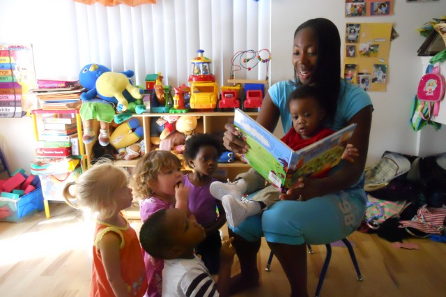 SCHOFIELD BARRACKS, Hawaii - LaQuanda Alston, a DFMWR FCC provider, reads a storybook to military children in her care at her home, recently.