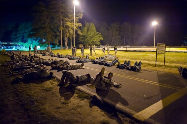 Competitors make final preparations moments before the opening ceremony of the 2011 Lt. Gen. David E. Grange Best Ranger Competition.