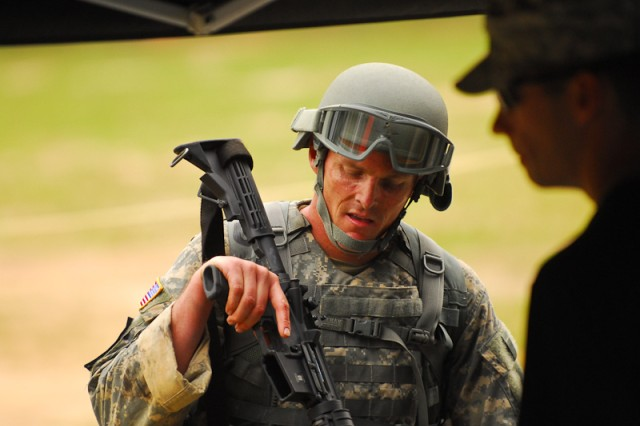 Team 8, Staff Sgt. Maj. Walter Zajkowski, United States Army Special Operations Command, checks his weapon prior to shooting at Malone 5.