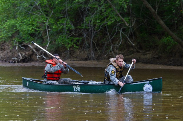Team 51, Capt. Hunter Southerland and Sgt. Sean Alpine, 3rd Infantry Regiment embark on the canoe portion of the 2011 Best Ranger Competition.