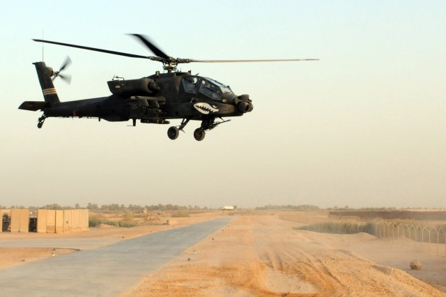 BABIL, Iraq - An AH-64D Apache helicopter lifts off from Contingency Operating Site Kalsu for a counter indirect-fire mission April 12, 2011. Soldiers of Company B, 1st Battalion, 229th Aviation Regiment, 21st Cavalry Brigade, are supporting the 3rd Armored Cavalry Regiment by providing ground surveillance of areas around Kalsu. US Army photo by Staff Sgt. Garrett Ralston (110412-A-8856R-023)