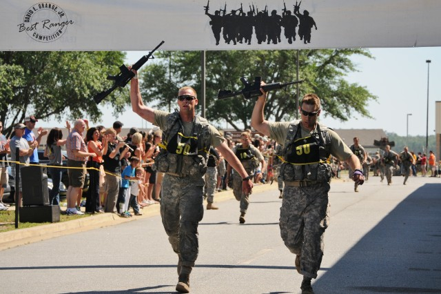 Maj. Edward Arnston, left, and Sgt. 1st Class John Rhoten, both of the Old Guard, cross the finish line of the final buddy run at the 2011 Best Ranger Competition April 17 at Fort Benning, Ga.