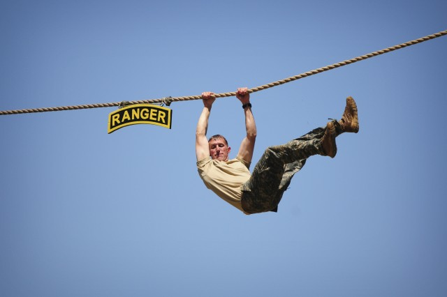 Sgt. 1st Class Mason Riepe completes the rope drop at Victory Pond on day three of the 2011 Best Ranger Competition.