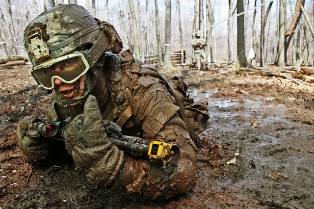 Crawling through mud, Pvt. Charles Shidler, Alpha Company, Special Troops Battalion, 37th Infantry Brigade Combat Team, Ohio National Guard, searches for the next covered fighting position during individual movement techniques training at the Camp Ravenna Joint Maneuver Training Center, Ravenna, Ohio, April 17, 2010. The IMT is just one of more than 200 common training tasks that Shidler, as well as about 3,600 other Soldiers of the 37th brigade, must complete before they are scheduled to deploy to Afghanistan in fall 2011 in support of Operation Enduring Freedom.  (Ohio National Guard photo by Sgt. Sean Mathis) (Released)