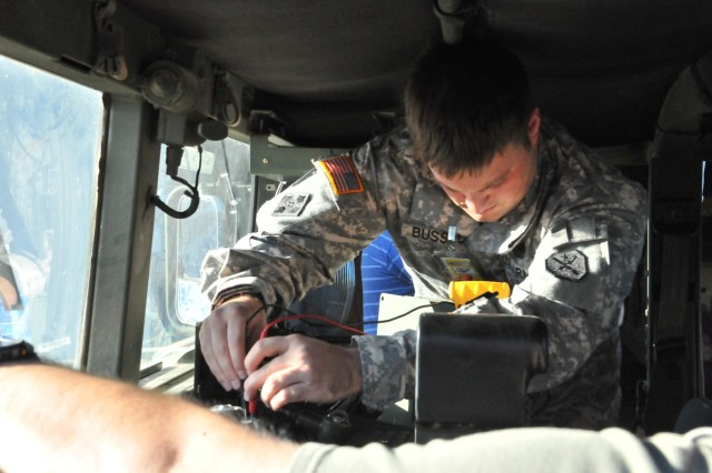 A Soldier performs a continuity check on the encryption device used with FBCB2 Joint Capabilities Release during a logistics demonstration at Fort Hood, TX in the fall of 2010.