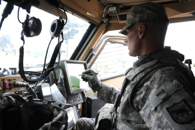 Sgt. 1st Class Joshua Cunningham types a message into the Force XXI Battle Command Brigade-and-Below/Blue Force Tracking (FBCB2/BFT) system during a mission on 23 Feb. in Kabul, Afghanistan. The latest version of FBCB2, Joint Capabilities Release (JCR), is among several systems that will undergo a Limited User Test with Soldiers as part of the Army's Network Integration Evaluation at White Sands Missile Range, N.M. in June.