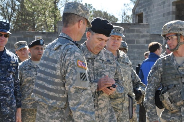 Gen. Peter Chiarelli, the Army's vice chief of staff, views a photo downloaded on a prototype JBC-P Handheld. Also pictured is Lt. Gen. William Phillips (second from right), principal military deputy to the Assistant Secretary of the Army for Acquisition, Logistics and Technology. Chiarelli and Phillips attended a recent field exercise at Ft. Bragg, N.C., where Paratroopers from the 3rd Brigade Combat Team of the 82nd Airborne Division experimented with the JBC-P Handheld prototype, the first developed under an Army effort to devise an Android-based smartphone framework and suite of applications for tactical operations.