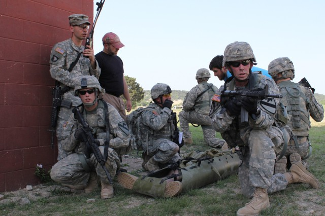 FORT HOOD, Texas-Flight medics from Company C, Task Force Lobos, 1st Air Cavalry Brigade, 1st Cavalry Division, pull security as a 'casualty' awaits air medical evacuation during a simulated mass casualty exercise here, April 9.