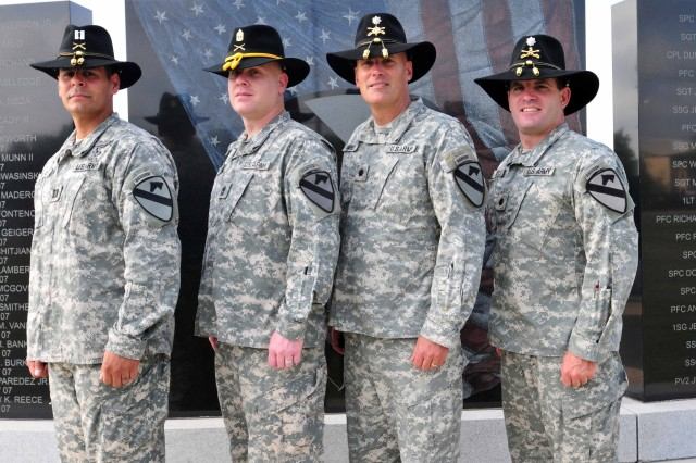 From left to right: Capt. William Soto, the executive officer of Headquarters and Headquarters Company, 2nd Special Troops Battalion; 1st Sgt. John Edwards, of A Compnay, 1st Battalion, 5th Cavalry Regiment; Lt. Col. Mark Davey, commander of 2nd Special Troops Battalion, 2nd Brigade Combat Team, and Lt. Col. Chip Daniels, commander of 1st Battalion, 5th Cavalry Regiment, stand together in front of the 1st Cavalry Division memorial, April 14, 2011. All four of these Soldiers graduated from the same Ranger Class in 1994 and now serve together in the 2nd Brigade Combat Team nearly 17 years later.