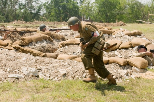 """In this image released by the Texas Military Forces, reenactment enthusiasts recreate a battle from World War II on Camp Mabry, Austin, Texas, Saturday, April 16, 2011. The show for service members, their families and civilians was a part of the American Heroes celebration. The two-day event was designed to increase the communication and interaction between the local community and the military. (Photo/100th Mobile Public Affairs Detachment, Army National Guard Sgt. Josiah Pugh) """""""