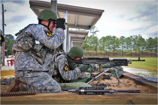 A Ranger team works together as shooter and spotter during the 2011 Best Ranger Competition at Fort Benning, Ga.