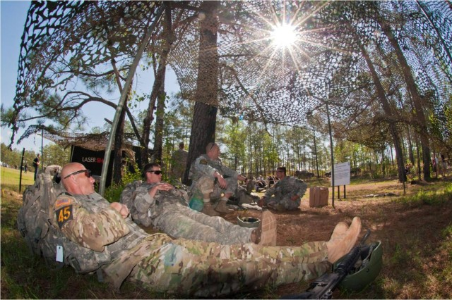Master Sgt. Jamie Newman and Sgt. 1st Class Jonathon Biltz, Ranger Training Brigade, rest before beginning the Laser Shoot at the 2011 Best Ranger Competition at Fort Benning, Ga.