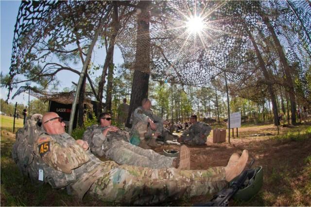 Master Sgt. Jamie Newman and Sgt. 1st Class Jonathon Biltz, Ranger Training Brigade, rest before beginning the Laser Shoot at the 2011 Best Ranger Competition at Fort Benning, Ga.