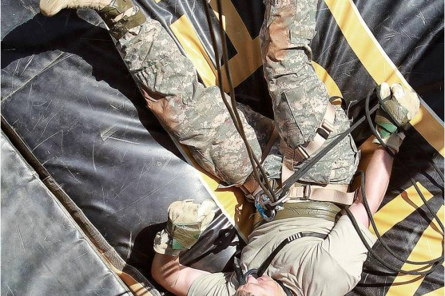 A competitor completes his rappel.