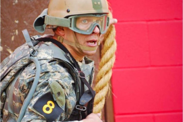 Master Sgt. Eric Turk lands after scaling a rope at the Urban Obstacle Course during Day 2 of the 2011 Best Ranger Competition at Fort Benning, Ga.