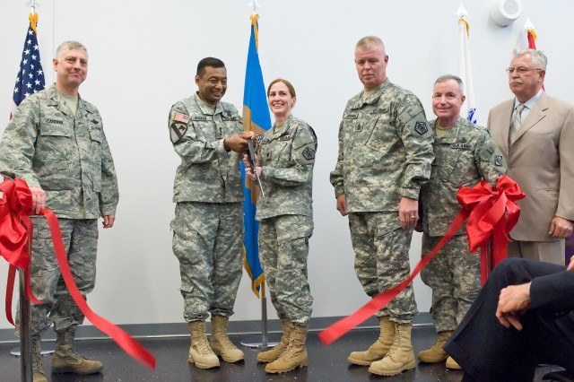 Participants in the Joint Personal Effects Depot ribbon-cutting ceremony at Dover Air Force Base, Del., April 15, were: (left to right) Col. Mark Camerer, commander, 436th Airlift Wing; Lt. Gen. Thomas Bostick, U.S. Army deputy chief of Staff, G-1; Lt. Col. Kelly Kyburz, commander, Joint Personal Effects Depot;  1st Sgt. Alfred Venham of the Joint Personal Effects Depot; Maj. Gen. Merdith W. B. (Bo) Temple, deputy Commanding general, U.S. Army Corps of Engineers; and Stephen Mockbee, founder and president, Bancroft Construction Company.