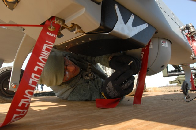 New York Army National Guard Sgt. Rocco Church performs a preflight safety inspection on the Shadow RQ-7 unmanned reconnaissance aircraft at Wheeler Sack Airfield on Fort Drum, N.Y., April 15, 2011.