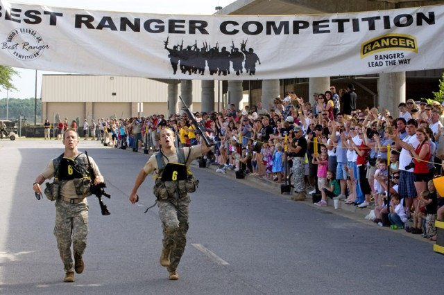 Master Sgt. Eric Ross (left) and Master Sgt. Eric Turk, representing the U.S. Army Special Operations Command, finish the last run as winners of the 2010 Best Ranger Competition at Fort Benning, Ga.