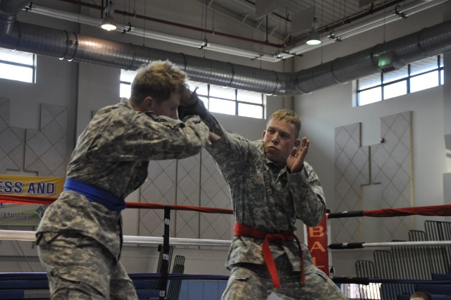 David Sorensen (right), 142nd Military Police Company, jabs Darek Gorring, 604th Air Support Operations Squadron, during the Area IV Better Opportunities for Single and Unaccompanied Soldiers  Combatives Tournament at Camp Carroll, South Korea Apr. 16.