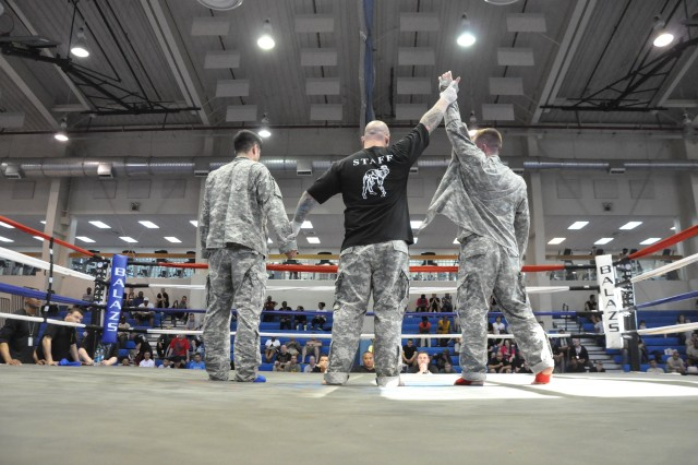 Matthew Heim (right), 498th Combat Sustainment Support Battalion, is declared the winner of the welterweight division during the Area IV Better Opportunities for Single and Unaccompanied Soldiers Combatives Tournament at Camp Carroll, South Korea Apr. 16. Heim beat Tyler Moyer of the 2nd Infantry Division.