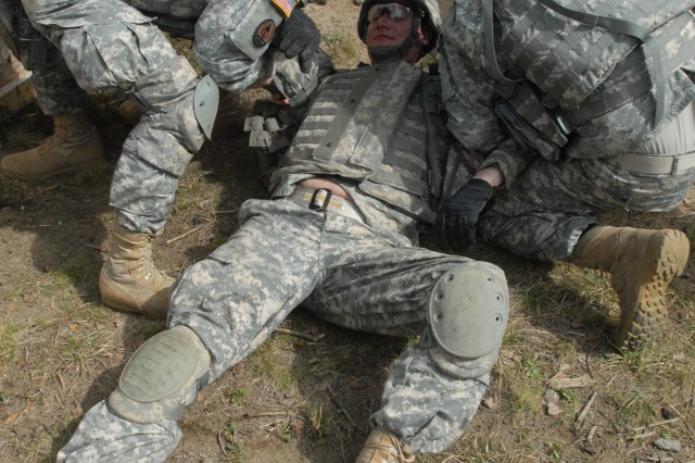 Soldiers attending the Warrior Leader Course, class 07-11 from Bravo Company, 7th Army Noncommissioned Officer Academy, conduct first-aid procedures to their injured comrades during an attack of their Combat Outpost by mock-insurgents while conducting a situational training exercise here April 11. The WLC is the initial leadership course for U.S. Army enlisted Soldiers where they are trained in various garrison and tactical leadership lessons while enhancing their leadership potentials. Under the auspice of the Joint Multinational Training Command, the 7th Army NCOA is the first and oldest NCOA in the U.S. Army, and works to build partnership capacity by incorporating relevant training to the contemporary operating environment. The JMTC is the only place in the U.S. Army that regularly trains with multinational partners.