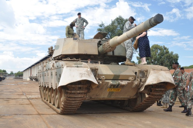 USARAF CSM Hu Rhodes (center, top) and members of his visiting party inspect a Republic of South Africa land forces tank during a recent visit with senior noncommissioned officers there.