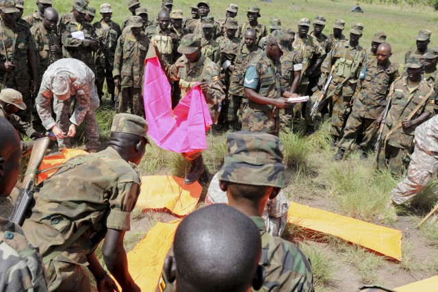 Uganda People's Defense Forces soldiers from the 27th Infantry Battalion train on setting up a drop zone with U.S. Soldiers from 3rd Squadron, 108th Cavalry Regiment, Georgia National Guard, at Drop Zone Red near Kapelebyong, Uganda, during Atlas Drop 11, April 14.