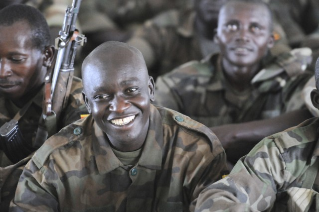 A Uganda People's Defense Forces Soldier smiles during a light moment in training at Drop Zone Red near Kapelebyong, Uganda, during Atlas Drop 11, April 14.