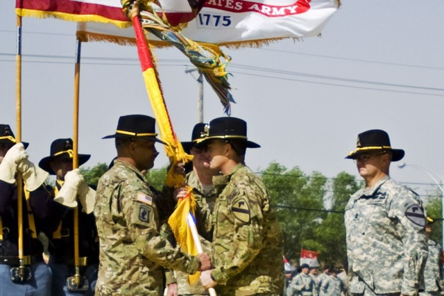 FORT HOOD, Texas - Maj. Gen. Dan Allyn (center), commander of the 1st Cavalry Division, passes the division's colors to Command Sgt. Maj. Isaia Vimoto during a change of responsibility ceremony, April 15, on Cooper Field.