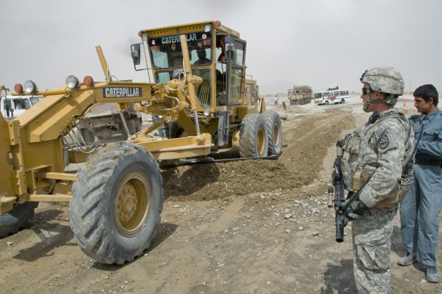 SPIN BOLDAK, Afghanistan - Pfc. Brandon Fender, enabler response team member, 525th Battlefield Surveillance Brigade, provides security at a reconstruction project along Highway 4 in Spin Boldak, Afghanistan, April 8, 2011.The highway is an economic corridor that allows passage from the Weesh crossing, near the Pakistan border, to Kandahar City in Afghanistan and is vital to the trade industry in the south. Pfc. Fender is an Omaha, Neb., native deployed from Fort Bragg, N.C. (U.S. Air Force Photo by Senior Airman Jessica Lockoski/16th Mobile Public Affairs Detachment)