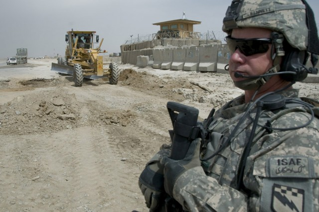 SPIN BOLDAK, Afghanistan -- Chief Warrant Officer 3 Kurt Bennett, tactical operations officer, enabler security team, 525th Battlefield Surveillance Brigade, secures a reconstruction project along Highway 4 in Spin Boldak, Afghanistan, April 8, 2011. The project will allow an easier passageway for vehicles traveling through the Weesh border crossing, near Pakistan, into Afghanistan. Chief Bennett is a Lancaster, Pa., native deployed from Fort Bragg, N.C. (U.S. Air Force Photo by Senior Airman Jessica Lockoski/16th Mobile Public Affairs Detachment)