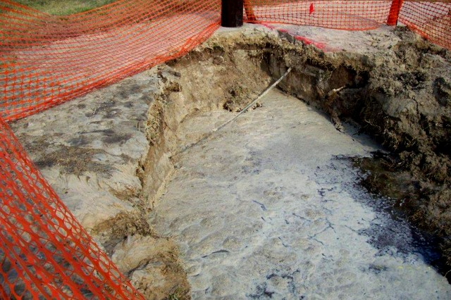 One of the two sinkholes caused by a watermain break aboard Naval Air Station Corpus Christi, April 15. U.S. Army Photo RELEASED