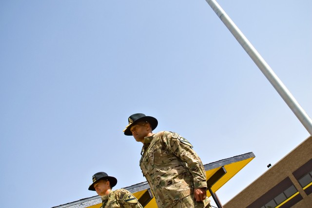 FORT HOOD, Texas- 1st Cavalry Division Commander, Maj. Gen. Daniel Allyn (left), and Sgt. Maj. Isaia Vimoto prepare to take their reigns  from the Horse Cavalry Detachment for a 'mounted inspection' of the 1st Cavalry Division troops on Fort Hood's Cooper Field April 15.