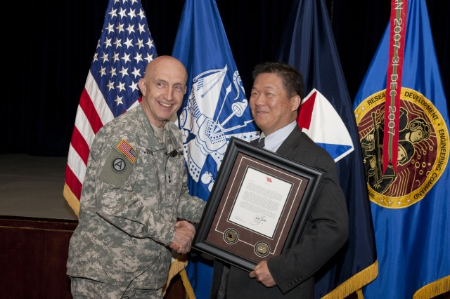 PICATINNY ARSENAL, N.J. - Maj. Gen. Nick Justice, Commanding General, U.S. Army Research, Development and Engineering Command congratulates Lu Ting on his selection as RDECOM's International Programs Person of the Year for 2010, April 18. Congratulations Lu.
