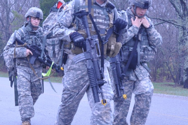 Spc. David Mensink, Sgt. James Swartz and Sgt. Bo Lollar, 789th Ordnance Company, 184th Ordnance Battalion, march to one of Fort Campbell's ranges to take part in one of the 52nd EOD Team of the Year scenarios. The Soldiers won the